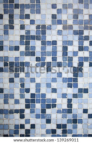 Blue Mosaic, detail of a wall decorated with blue tiles, textured background, modern