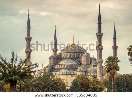 Blue mosque in Istanbul - famous landmark of islam architecture in Turkey. Four minarets of ancient mosque at cloudy sky, ottoman architecture style.  - stock photo