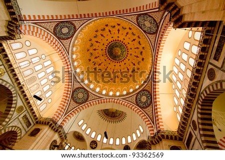 Blue Mosque in Istanbul Turkey with beautiful mosque dome ceiling decorated with thousands of hand made tiles. - stock photo