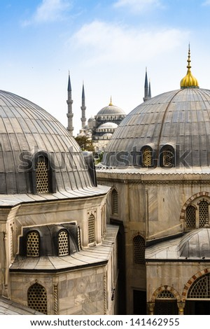 Blue Mosque or Sultan Ahmed Mosque viewed trough the window of Hagia Sophia, former Orthodox patriarchal basilica (church), later a mosque, and now a museum in Istanbul, Turkey. - stock photo