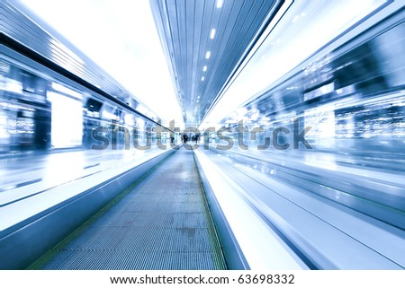 blue motion of business passage, escalator in airport - stock photo