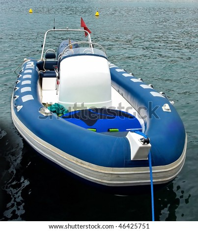 Blue motor inflatable boat in Spain.