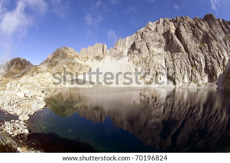 blue mountain lake with a reflection on the background of the Dolomites mountains