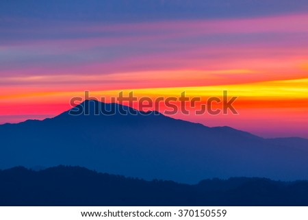 blue mountain silhouette on a sky background - stock photo