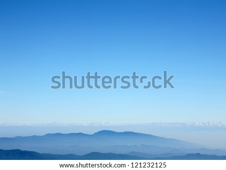 Blue mountain with blue sky and clouds background - stock photo