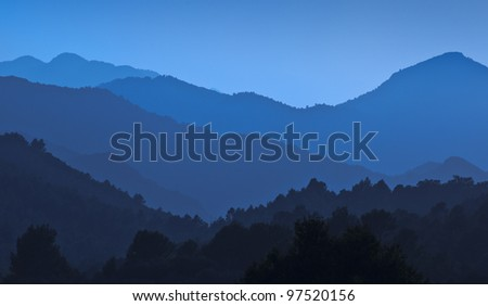 Blue mountains and forests - stock photo