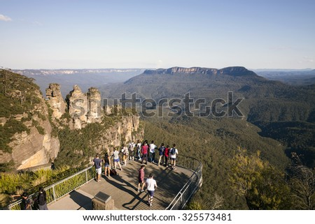BLUE MOUNTAINS (NEW SOUTH WALES), AUSTRALIA - Sept 13, 2015 - Visitors enjoying the mountain view at The Three Sisters, Blue Mountain, Australia. - stock photo