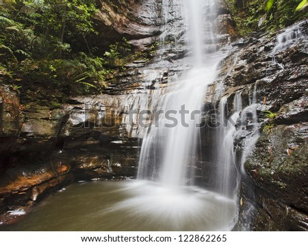 blue mountains powerful waterfall Empress fall close up view between rocks result of stream erosion summer day time - stock photo
