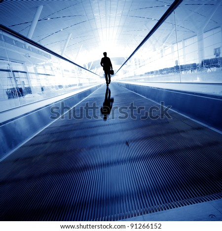 Blue moving escalator in the office hall perspective view - stock photo