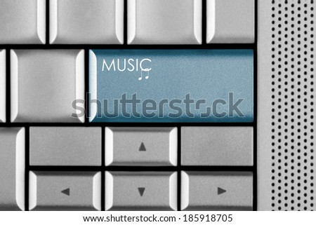 Blue Music key on a computer keyboard with clipping path around the Music key - stock photo