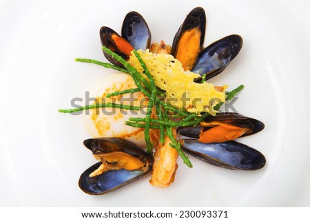 Blue mussels, shrimp and scallops dish prepared at a restaurant, shot on white, horizontal orientation full color image - stock photo