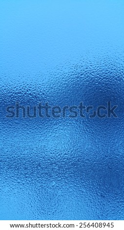 Blue natural background with water drops on glass - stock photo