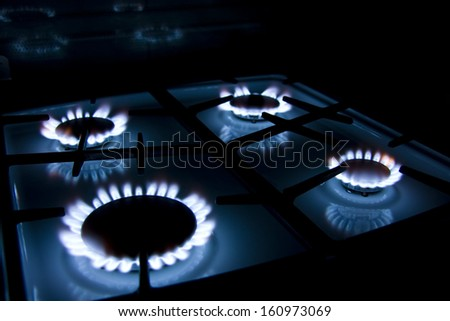Blue Natural Gas Flames on Kitchen Oven - stock photo