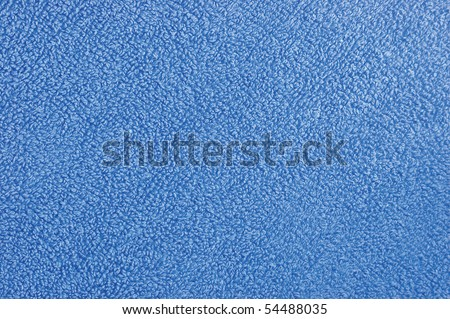Blue natural plush terry cloth turkish bath / beach towel, textured fabric macro background closeup texture