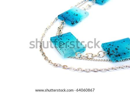 Blue  necklace isolated on white background. - stock photo