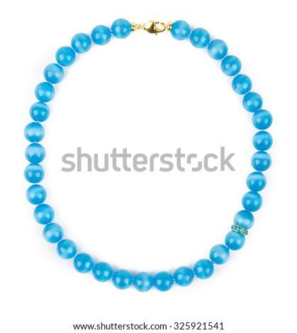 Blue necklace of cat's eye lying round on white background. - stock photo