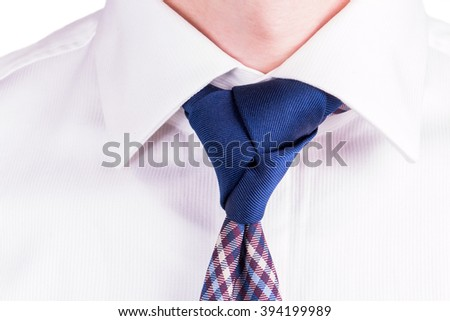 Blue Necktie with Trinity Tie Knot on a White Shirt - stock photo