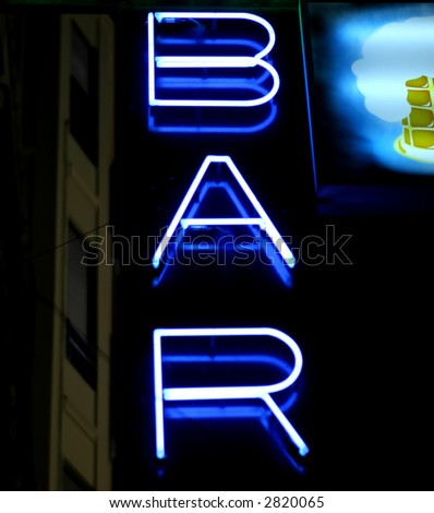 Blue neon wine bar sign at night in summer, with copy space. - stock photo