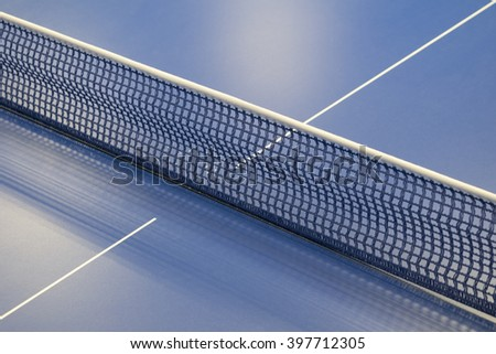 blue net for pingpong and a tennis table - stock photo
