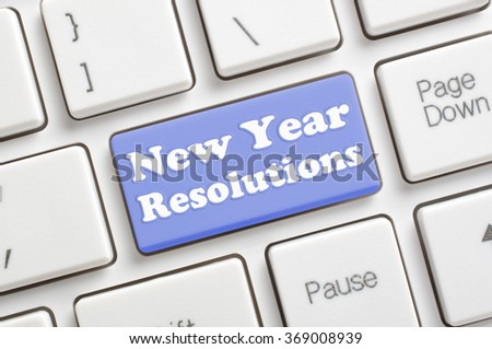 Blue new year resolutions key on keyboard - stock photo