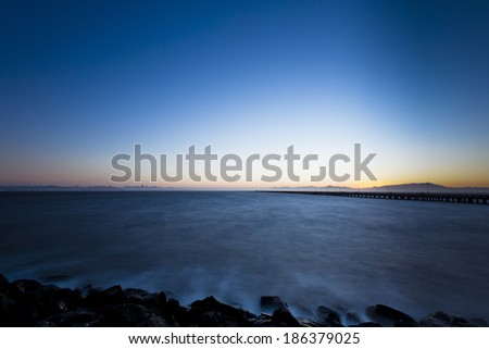 Blue nightfall waterfront scenic  - stock photo
