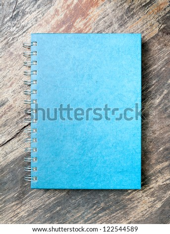 blue note book on grunge wood
