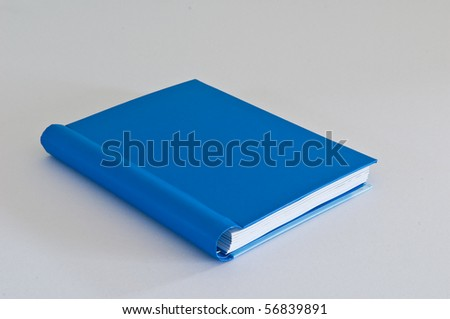 blue notebook on white background