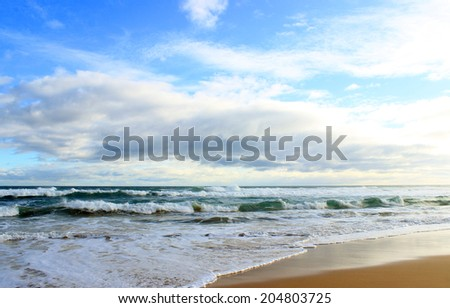 Blue ocean and clouds - stock photo