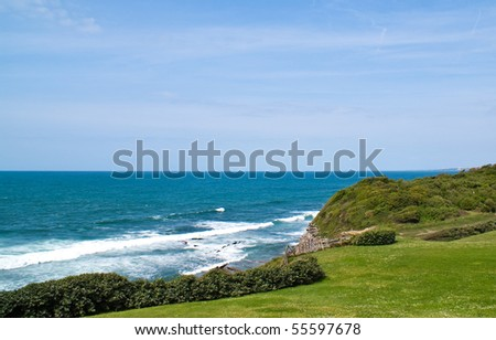 blue ocean and high cliff - stock photo