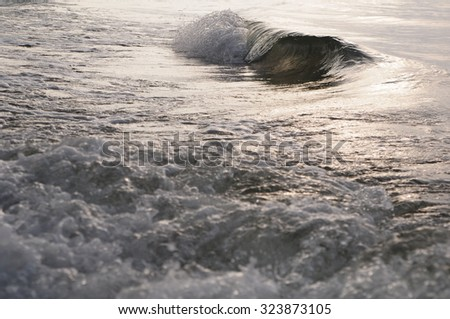 Blue Ocean or Sea Wave during sunrise or sunset  - stock photo