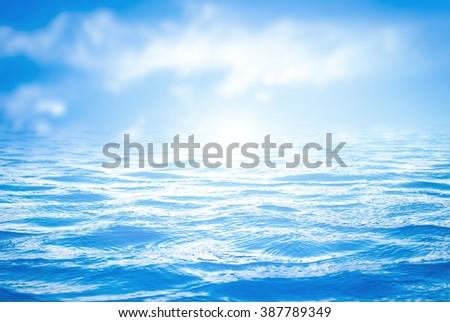 Blue ocean. Sky, Texture, Surface, Earth, Blur, Wet, Light, View, Sea, Air, Sun, Wave, Clean, Nature, Surf, Season, Vivid, Color, Calm, Clear, Fresh, Soft, Travel, Peace, Cloud, Sunny, Shore concept. - stock photo