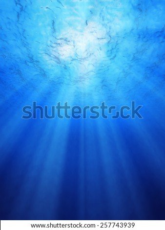 Blue ocean underwater light rays shining for backgrounds. - stock photo