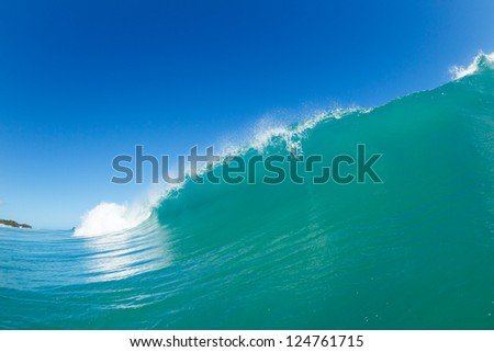Blue Ocean Wave and Sunny Blue Sky - stock photo