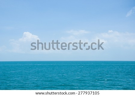 Blue ocean with still wave and clear blue sky  - stock photo