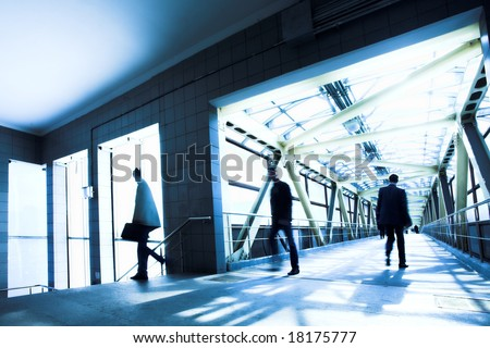 Blue office corridor, people mooving near staircase