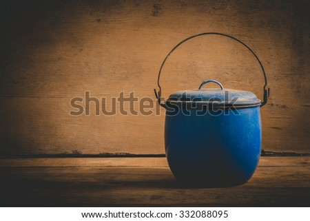 Blue old pot on wooden, Vintage