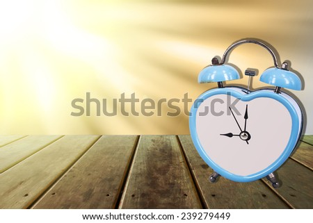 blue old retro clock on sunlight ,wooden floor background ,abstract background to memory of last time.  - stock photo