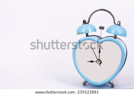 blue old retro clock on white background ,abstract background to memory of last time. - stock photo