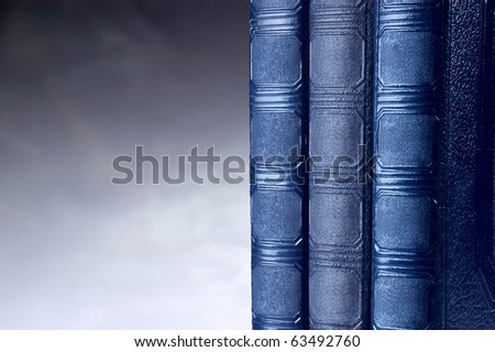 Blue old vintage books on studio background with copy space - stock photo