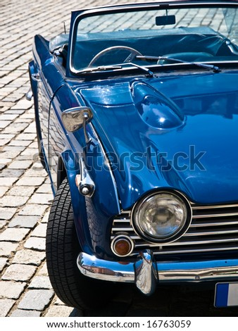 Blue Oldtimer in perfect condition posing on a street - stock photo