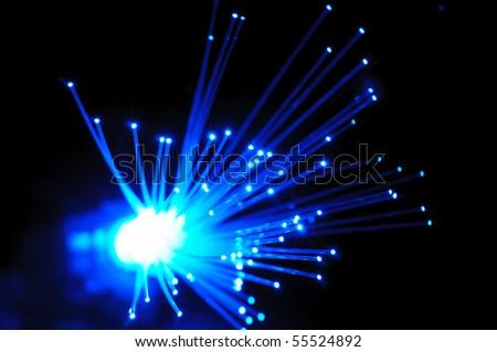 Blue optical fibers against  the black background - stock photo