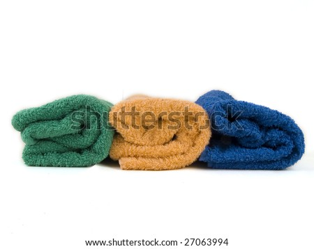 Blue, orange and green towels on white background
