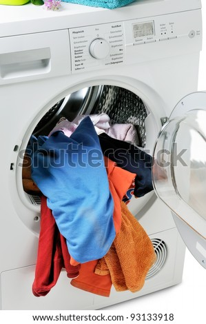 blue, orange towels in an open washing machine - stock photo