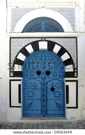 "Blue oriental doors in Sidi Bou Said, ""Blue city"", Tunisia - stock photo"
