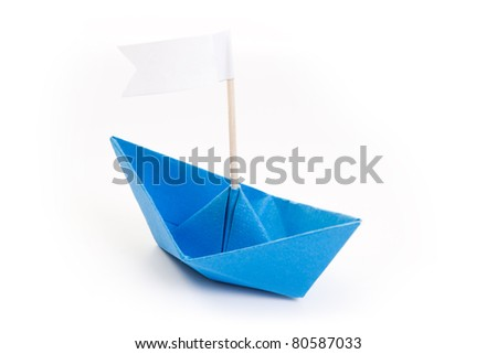 blue origami boat with white flag - stock photo