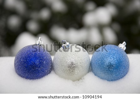 Blue ornaments in the snow