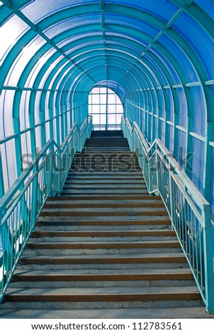 Blue overhead pedestrian crossing - stock photo
