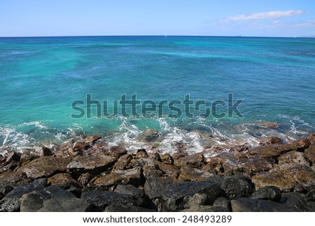 Blue Pacific from breakwater - Oahu, Hawaii - stock photo