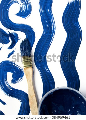blue paint and a brush - stock photo
