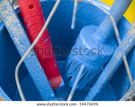 Blue paint blue brush and blue can. - stock photo